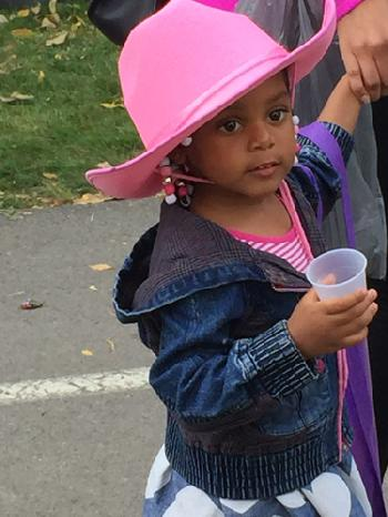 Girl in pink cowboy hat