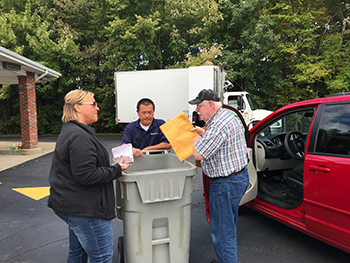 assisting members with shredding